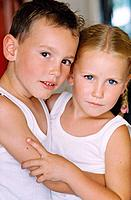Boy and Girl Wearing Vests Embracing
