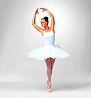 Full length of a young ballet dancer wearing tutu against white background _ copyspace