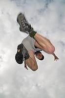 Caucasian male, jumping, Alberta, Canada.