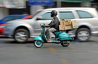 motor scooter in the road traffic used as a transporter, Thailand, Bangkok