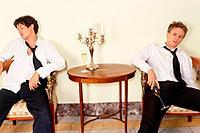 Two men sitting drunken at the table
