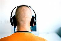 Man with Bald Head Wearing Headphones