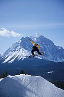 A snowboarder catching some air at Lake Louise resort, Banff National Park, Alberta, Canada