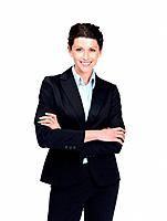 Portrait of a smiling young entrepreneur female standing with folded hands against white background