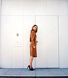 Young Businesswoman Outside Office Door