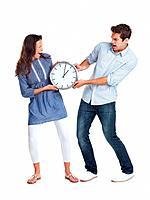 Portrait of an angry young couple having an argument on a clock against white background