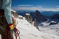 A female climber ascends the Northeast Ridge _ North Howser, Bugaboos, BC