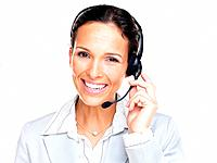 Portrait of a confident young female customer service agent with headset isolated over white background
