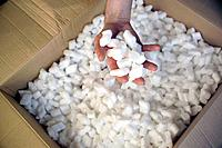 Hand Holding Packing Peanuts