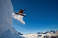 A backcountry snowboarder launches a cornice, Healy Pass, Banff National Park, Alberta, Canada