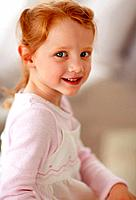Closeup portrait of an adorable little girl giving you a cute smile