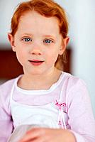 Closeup portrait of an innocent little girl giving you a cute smile