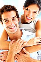 Closeup portrait of young happy man and woman couple in love