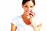 Portrait of healthy young lady eating an apple against bright background