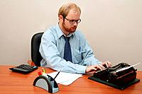 Office. Man typing on Antique Typewriter!