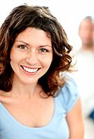Closeup portrait of pretty mature lady smiling with a man in background
