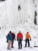 Group of ice climbers at a frozen waterfall. Wintertime scenic, Ontario, Canada.
