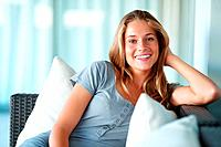Portrait of a charming young woman relaxing on sofa at home _ Indoor
