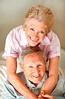Portrait of a joyful mature couple smiling together
