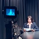 Newsreader in a television news studio