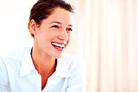 Portrait of happy female professional smiling at office