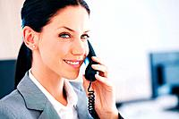 Closeup of elegant business woman smiling while speaking on phone call at office