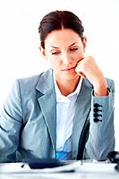 Portrait of unhappy female executive thinking over white background