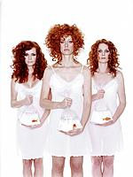 Three Curly_Haired Women Holding Plastic Bags with Goldfish