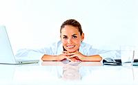 Portrait of pretty young female executive relaxing at desk