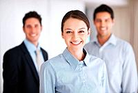 Portrait of beautiful business woman smiling with colleagues in background