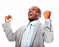 Happy middle aged male executive celebrating success with clenched fists over white background