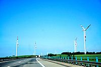 Highway and wind turbines in the foreground