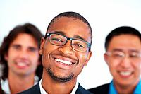 Closeup of African American business man smiling with executives in background
