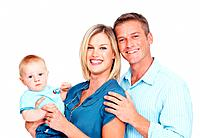 Portrait of beautiful Caucasian couple smiling with cute baby on white background