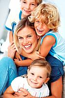 Portrait of beautiful woman having fun time with three children