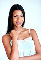 Portrait of attractive mixed race woman smiling on plain background