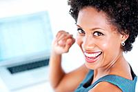 Closeup of successful female executive smiling while working on laptop