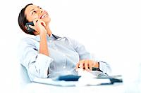 Laughing mixed race business woman using mobile phone at work