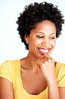 Closeup of charming African American woman laughing over white background