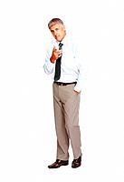 Full length of male executive pointing at you over white background