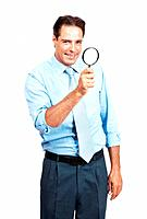 Portrait of a smart mature business man holding a magnifying glass in hand over white background