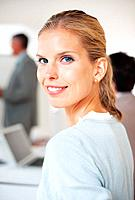 Closeup portrait of a smart young businesswoman attending a meeting with her colleagues at office
