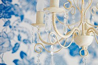 vintage chandelier in front of white_and_blue background