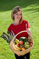 handsome young woman with fruit basket, Germany