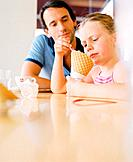 Father and Daughter in Ice Cream Parlor
