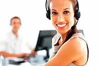 Closeup portrait of pretty customer care representative smiling while at work