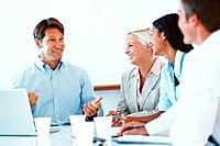 Cheerful young business man discussing with his team during a meeting