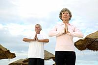 Senior Couple Doing Yoga Exercise