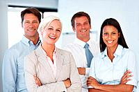 Group of a happy young businesspeople standing together with folded hands