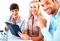 Portrait of business team smiling during meeting